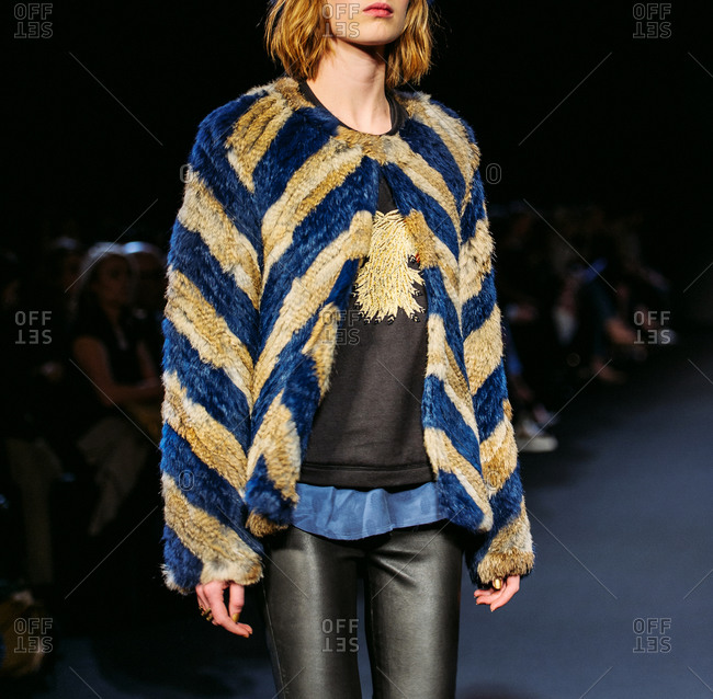 Paris, France - March 5, 2013: Fur coat with leather trousers on model at the Zadig and Voltaire fashion show