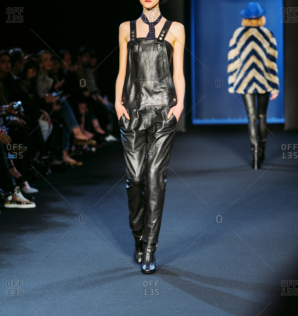 Paris, France - March 5, 2013: Model wearing black leather overalls with scarf at the Zadig and Voltaire fashion show