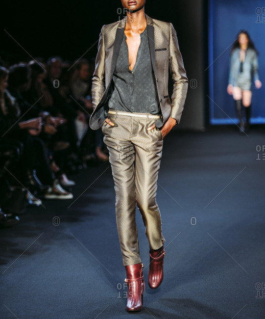 Paris, France - March 5, 2013: Model in khaki metallic suit with cognac boots at the Zadig and Voltaire fashion show