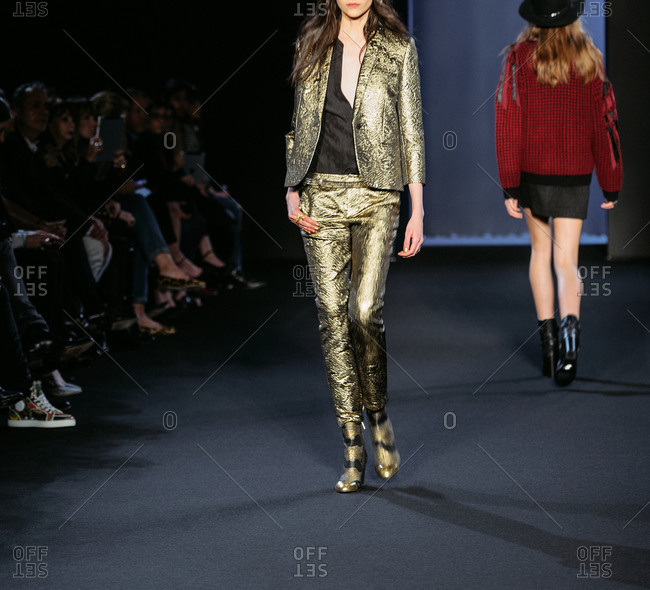 Paris, France - March 5, 2013: Model in golden metal jacquard suit at the Zadig and Voltaire fashion show