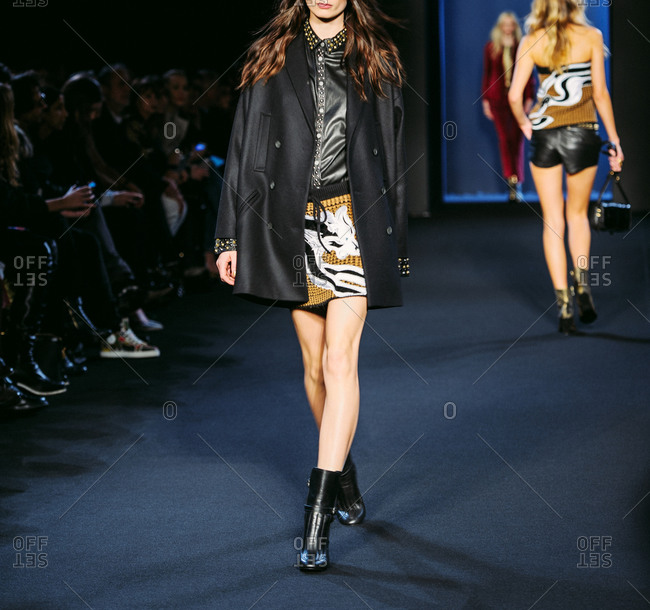 Paris, France - March 5, 2013: Model in black double-chest wool coat  at the Zadig and Voltaire fashion show