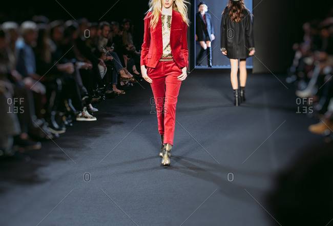 Paris, France - March 5, 2013: Model in red velvet suit and metallic jacquard blouse at the Zadig and Voltaire fashion show