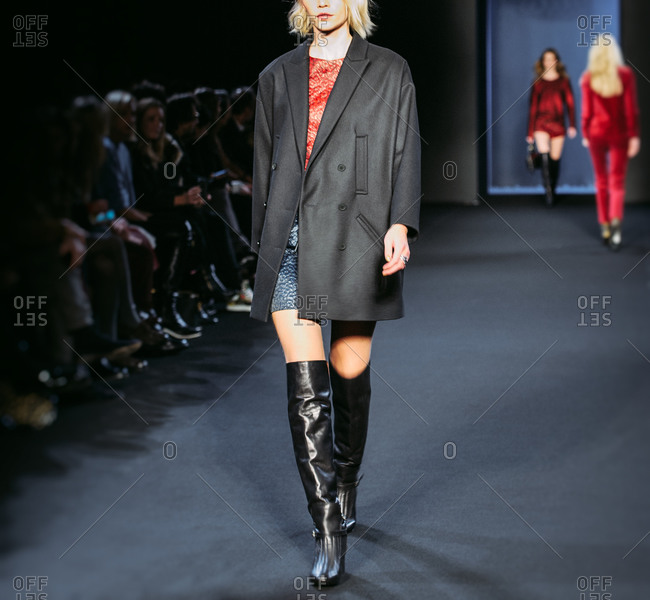 Paris, France - March 5, 2013: Model with double chest wool coat over dress at the Zadig and Voltaire fashion show