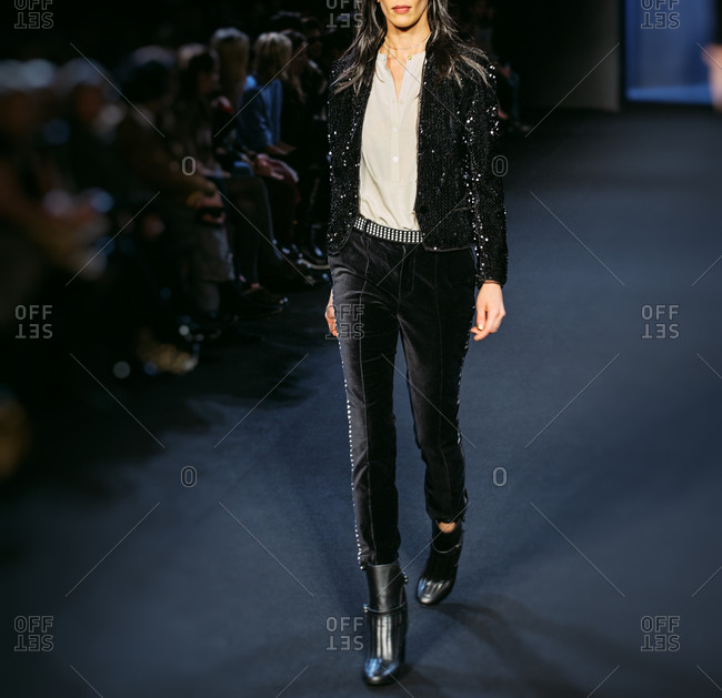 Paris, France - March 5, 2013: Model with black glitter jacket and pants at the Zadig and Voltaire fashion show