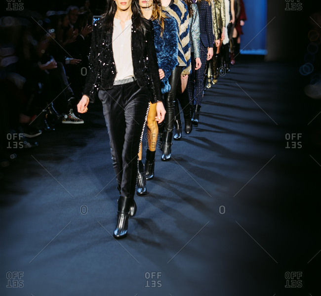 Paris, France - March 5, 2013: Models walking at end of the