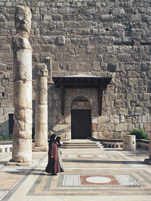 Women walking outside the gates of Damascus, Syria