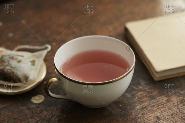 Pink tea served in a mug