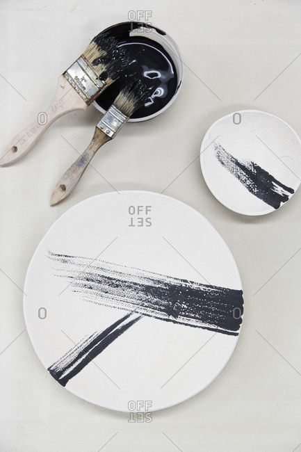 Black stripes painted onto white ceramic plates