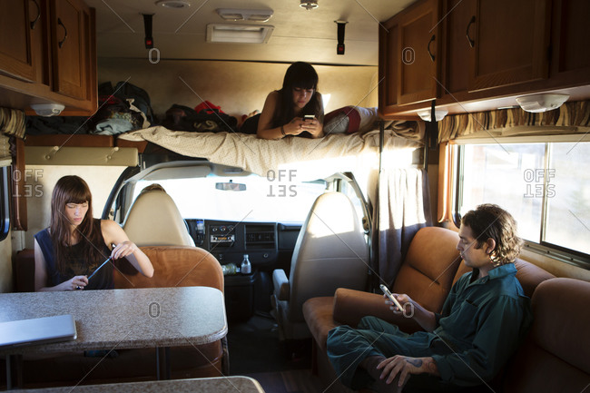 Group of friends in RV passing time