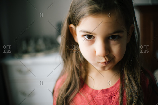 Young girl with a skeptical expression on her face