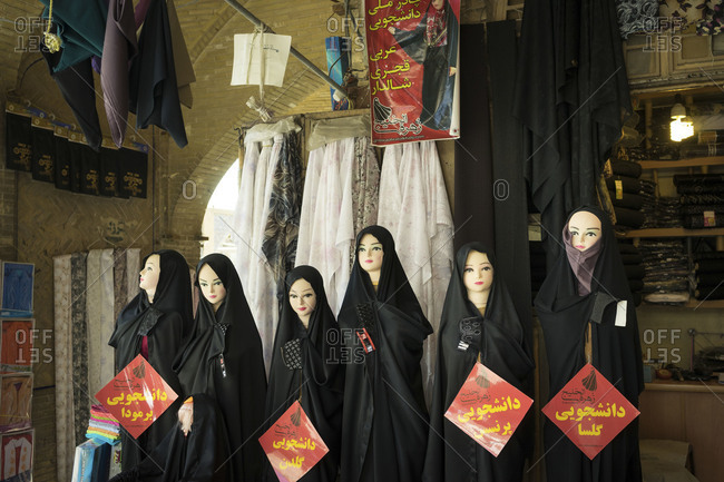Isfahan, Iran - June 18, 2014: Traditional Islamic black chadors are sold at the local Bazaar