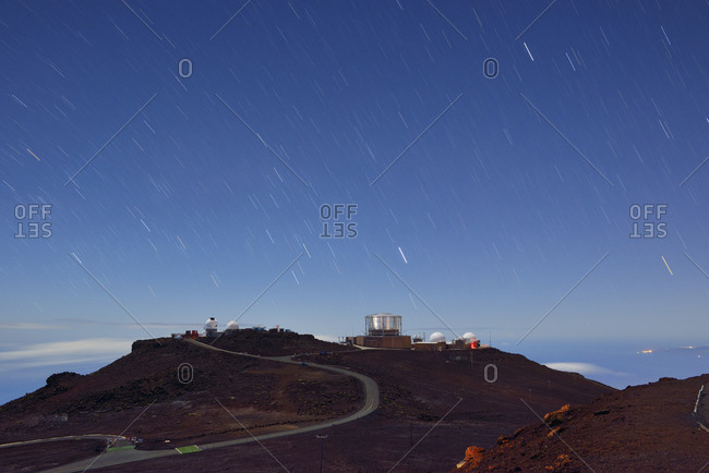Maui, Hawaii, USA - December 24, 2013: Observatory on mountain top under starry sky, Maui