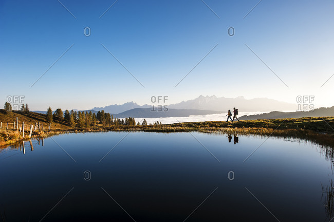 Hikers at mountain lake in the Lower Tauern, Altenmarkt-Zauchensee