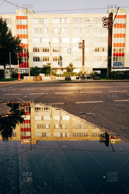 Berlin, Germany - September 17, 2014: Facade of a commercial house reflected in a puddle