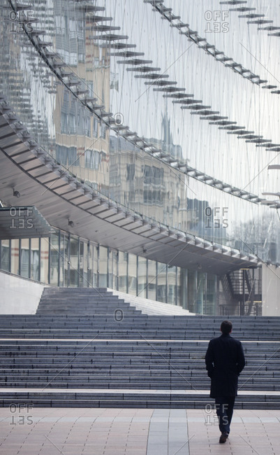 A man walks towards the European Parliament building in Brussels, Belgium
