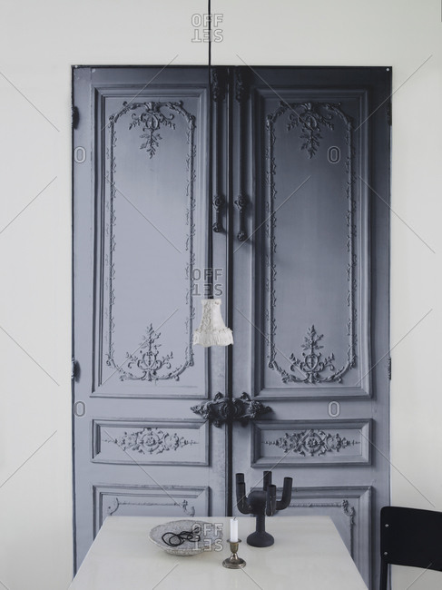 Table in front of an ornate door