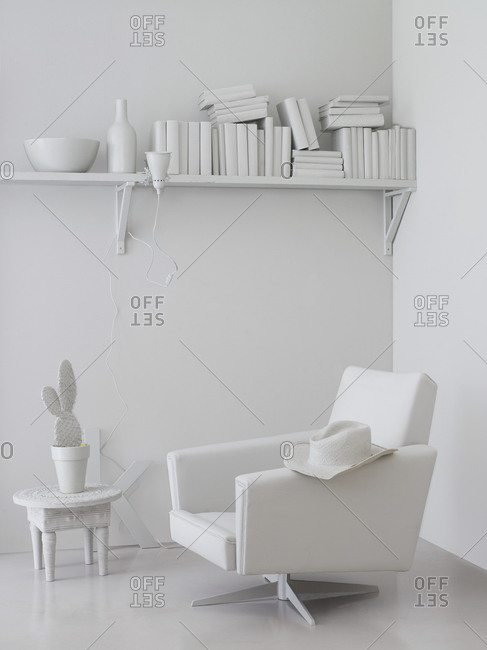 All-white interior with a retro armchair