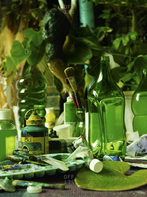 Green bottles and paint tubes
