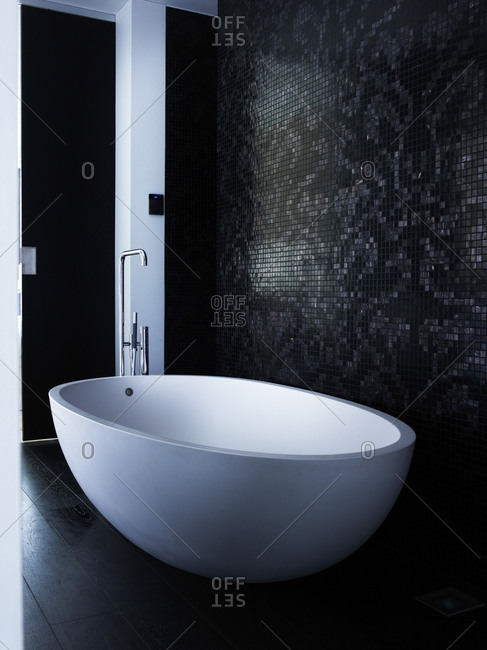 Bathroom interior with an oval bathtub