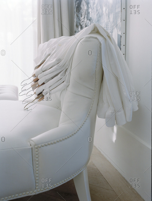 White armchair with white shirts