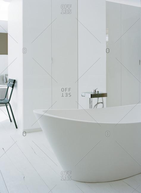 Interior design of a bathroom with a white bathtub