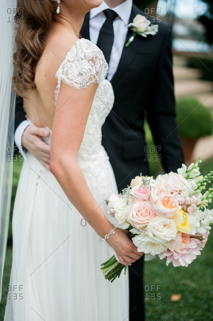 Neck-down portrait of a bride and groom