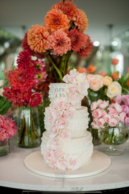 Three-tiered wedding cake with a cascade of pale pink roses