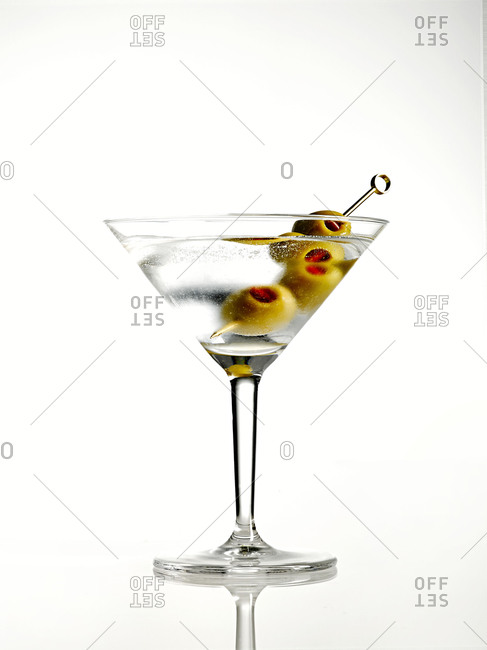 A martini with three olives