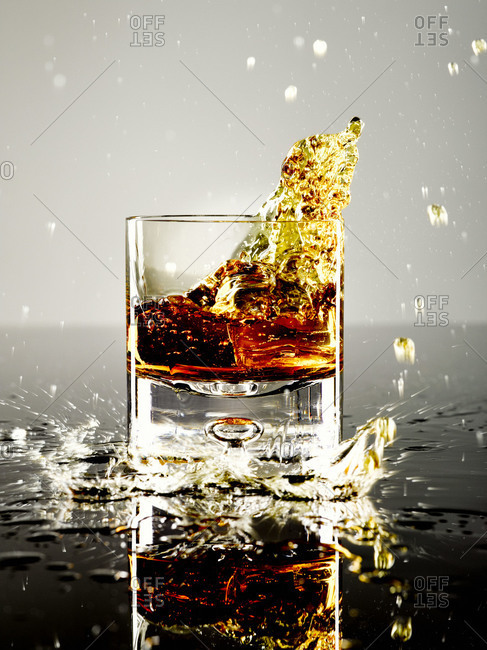 Whiskey spilling out of a glass