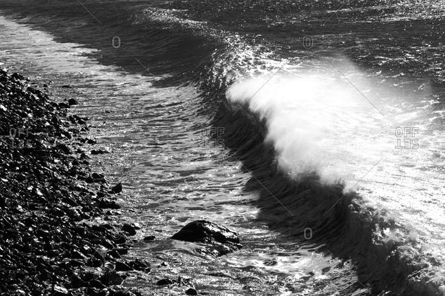 Waves breaking on the shore in Malibu, California