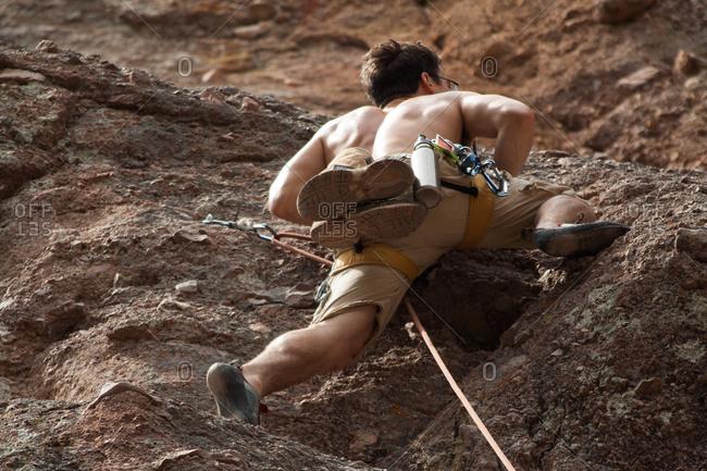 Man climbing a cliff in Pinnacles National Monument, USA
