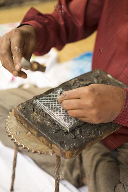 Indian man doing handicraft work
