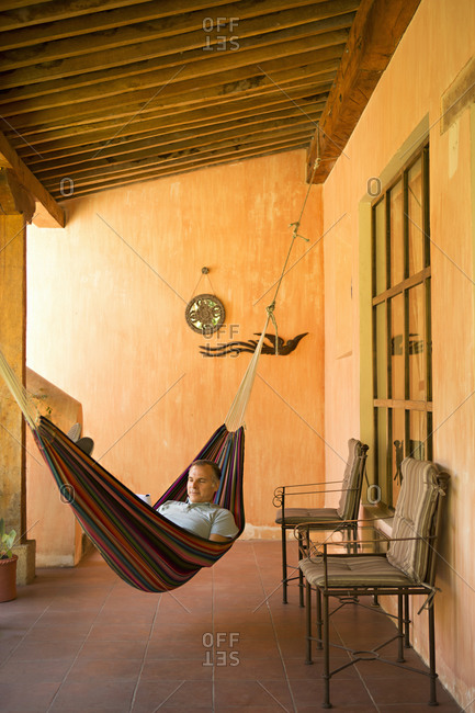 Man on hammock on terrace in Guatemala