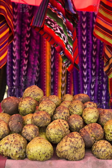 Cherimoya fruit and textiles in Guatemala