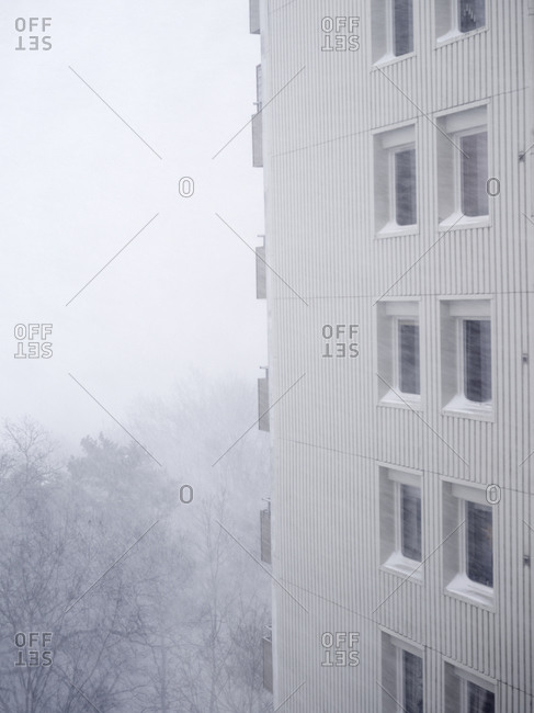 Corner of an apartment building in foggy day