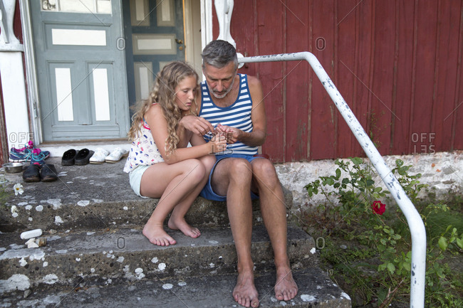 Father with daughter in front of the house