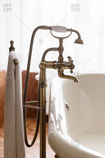 Free standing bath with old-fashioned tap