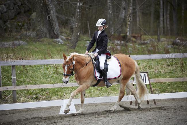Girl riding horse - Offset Collection