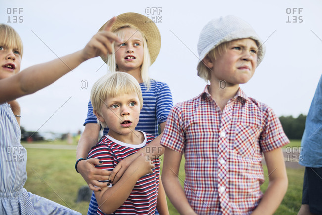 Group of blond children looking at something in the distant