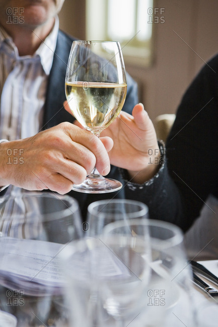 Hands with wine glass