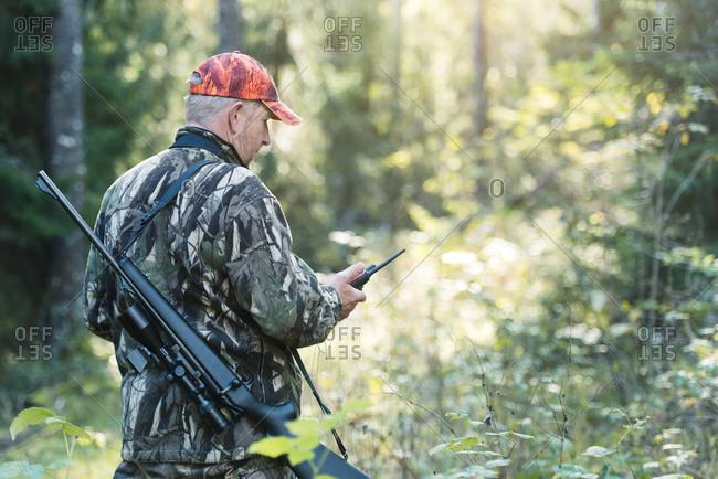 Hunter with walkie talkies