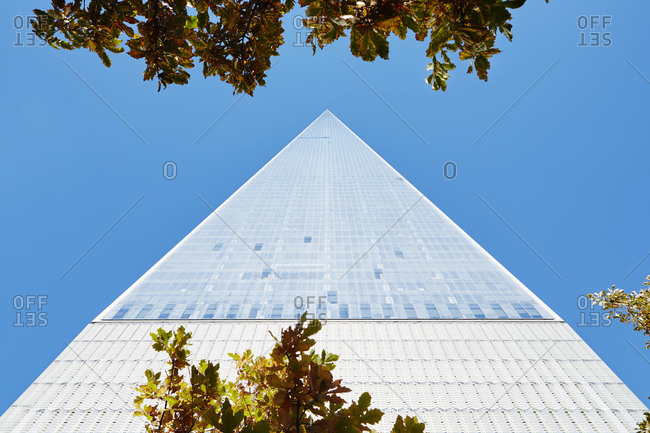 New York City, New York - November 3, 2014: Looking up at One World Trade against blue sky