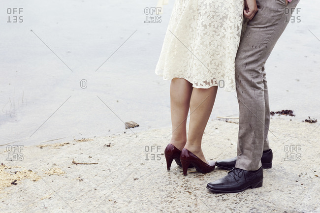 Low section view of a bride and groom