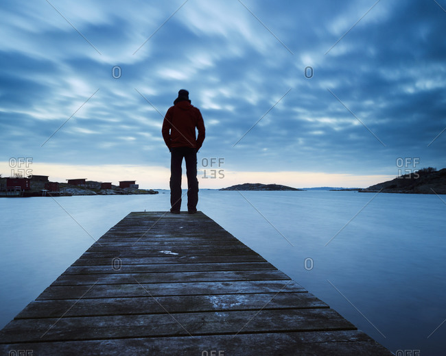 Man on jetty looking at view