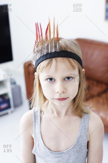 Portrait of girl in feather headdress