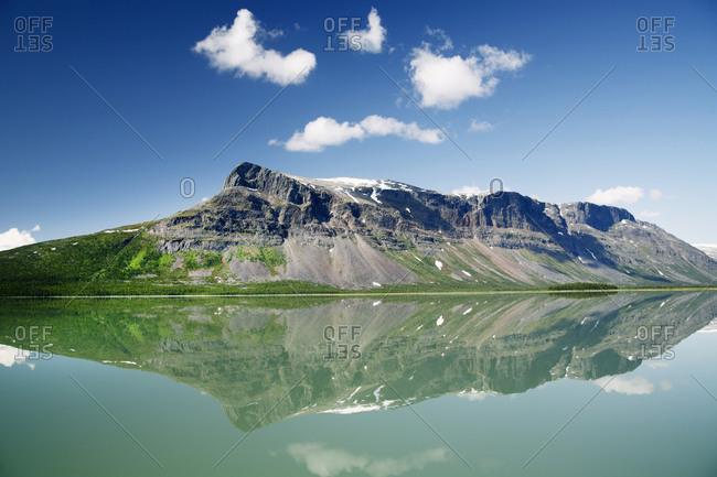 Ridge reflecting in lake - Offset