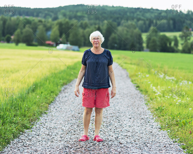 Senior woman on gravel road
