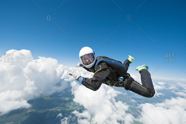 Sky-diver freefalling in air