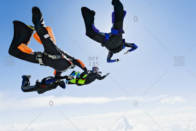 Sky-divers getting into formation in air