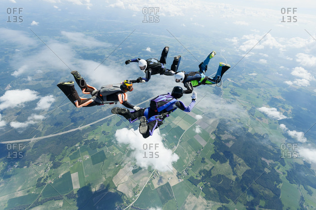 Sky-divers in air with land below